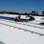 Solar Panel Installation on Commercial Rooftop MM Electrics Biloela